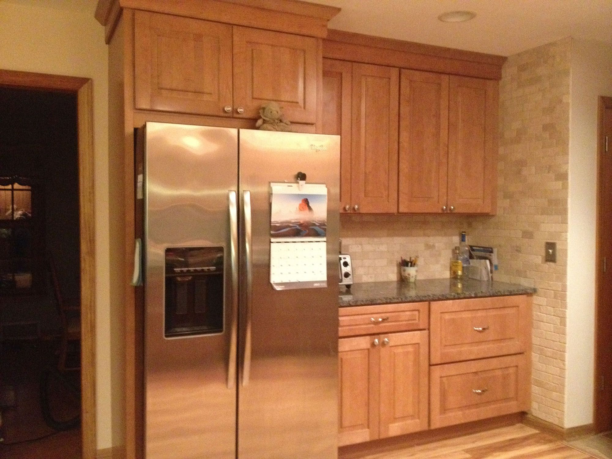 Kitchen Backsplash By Window large kitchen has semi custom maple cabinets in a shaker style