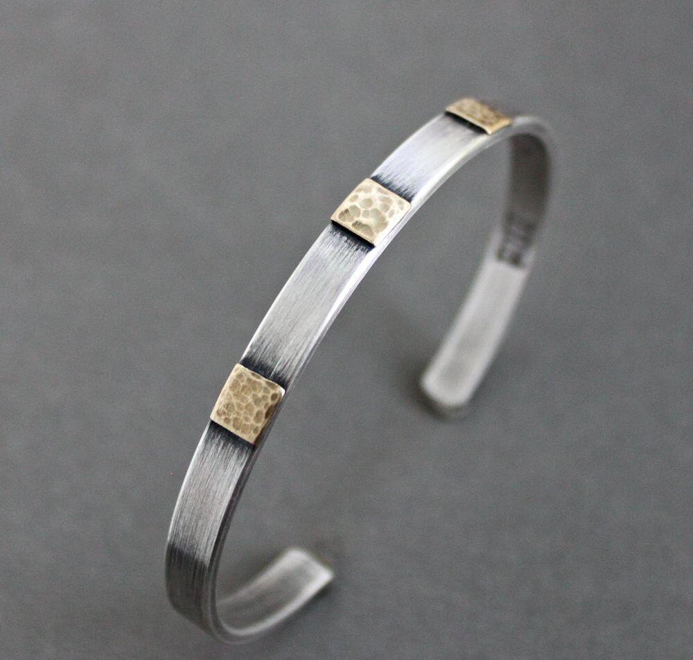 Men's Cuff Bracelet Sterling Silver and Brass by LynnToddDesigns on Etsy https://www.etsy.com/listing/241732317/mens-cuff-bracelet-sterling-silver-and