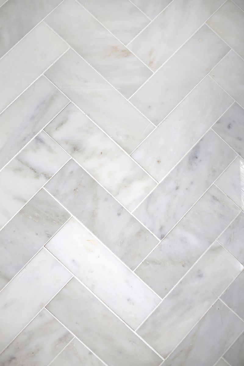 Try This: Herringbone Marble Tile (A Beautiful Mess) | Marble tiles ...