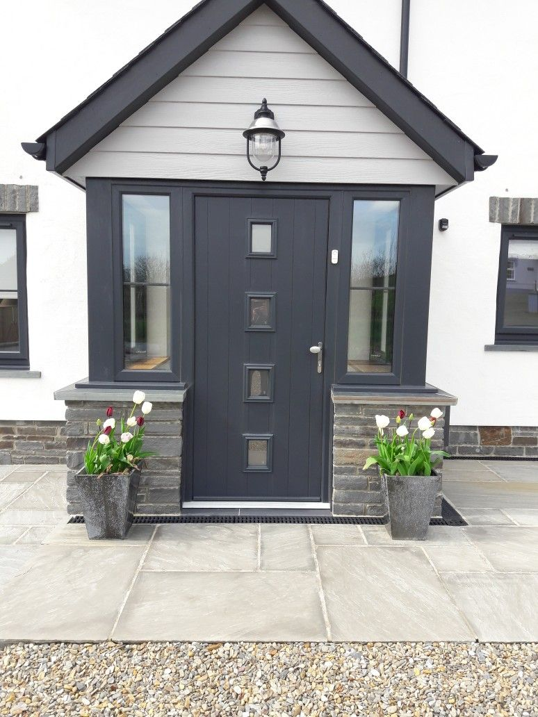 Anthracite composite front door and Marley Cedral cladding in light ...