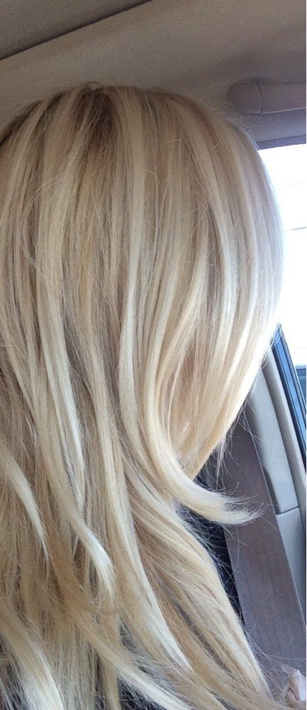 Mikel's the Paul Mitchell Experience - My gorgeous blonde hair that Luis color corrected from brassy blonde to a creamy blonde. I love it! Never going anyplace else! - Tampa, FL, United States