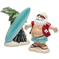 """Hawaiian Surfing Santa Claus Collectible Ceramic Salt and Pepper Shaker Set by COSMOS GIFTS CORP. $14.98. Ceramic shakers portray Santa in Hawaiian garb with surfboard.. Cute collectible and table accent.. 3.5"""" tall.. Whimsical ceramic shakers portray Santa in Hawaiian garb with surfboard--and not a sleigh in sight! Cute collectible and table accent. 3.5"""" tall."""