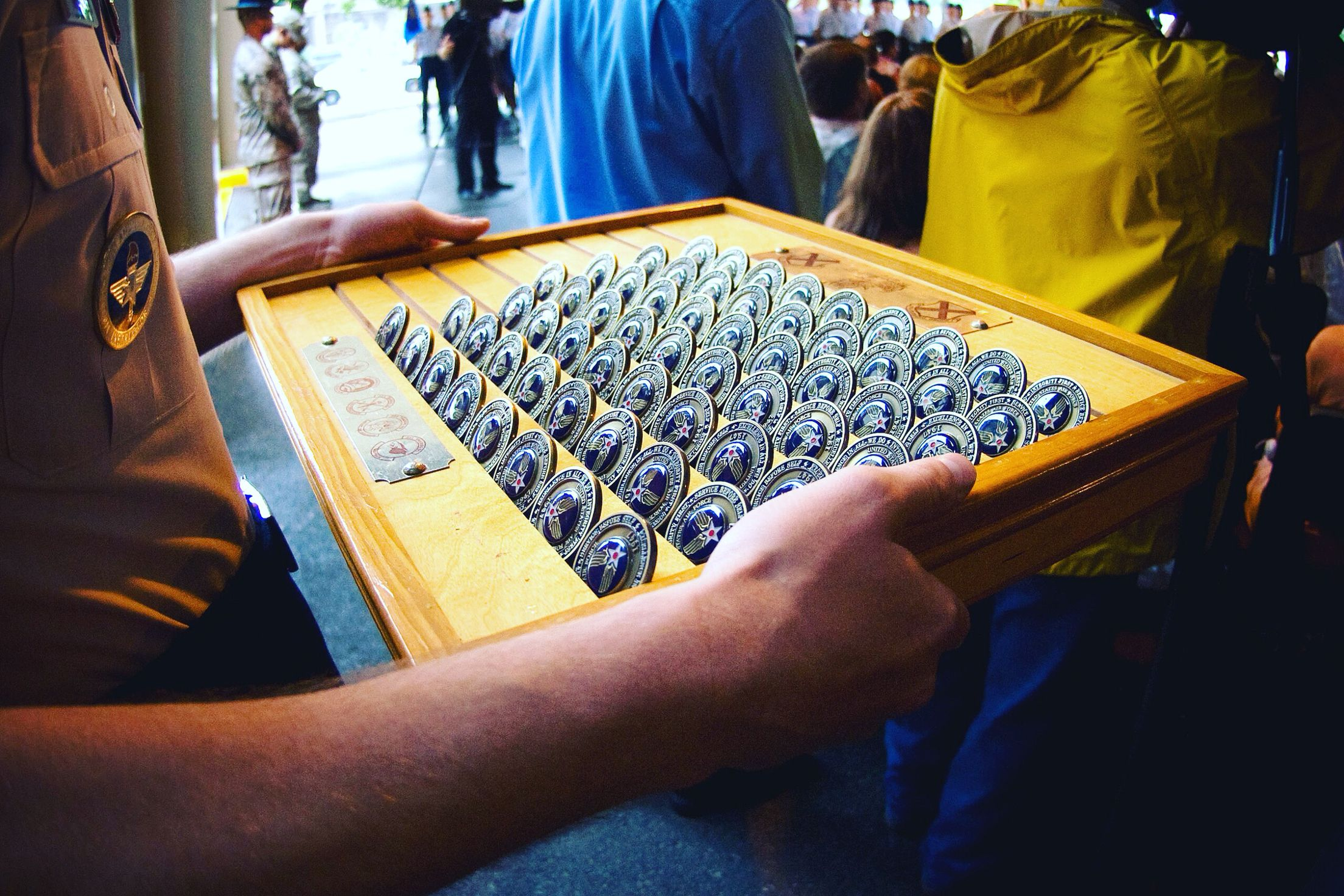 A training instructor waits to pass out coins during a