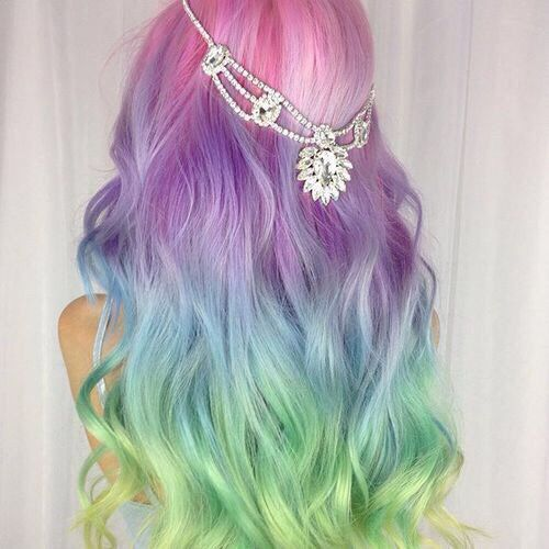 Long dyed rainbow curly hair by Amythemermaidx