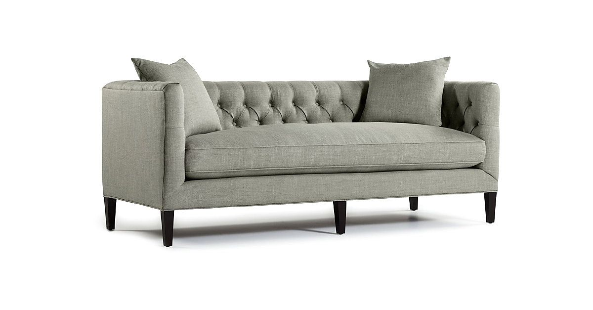 Featuring track arms, an exquisite button-tufted back, and a box bench cushion, this upholstered sofa has a sophisticated and stately appeal. Tapered legs in an espresso finish complete the look of...