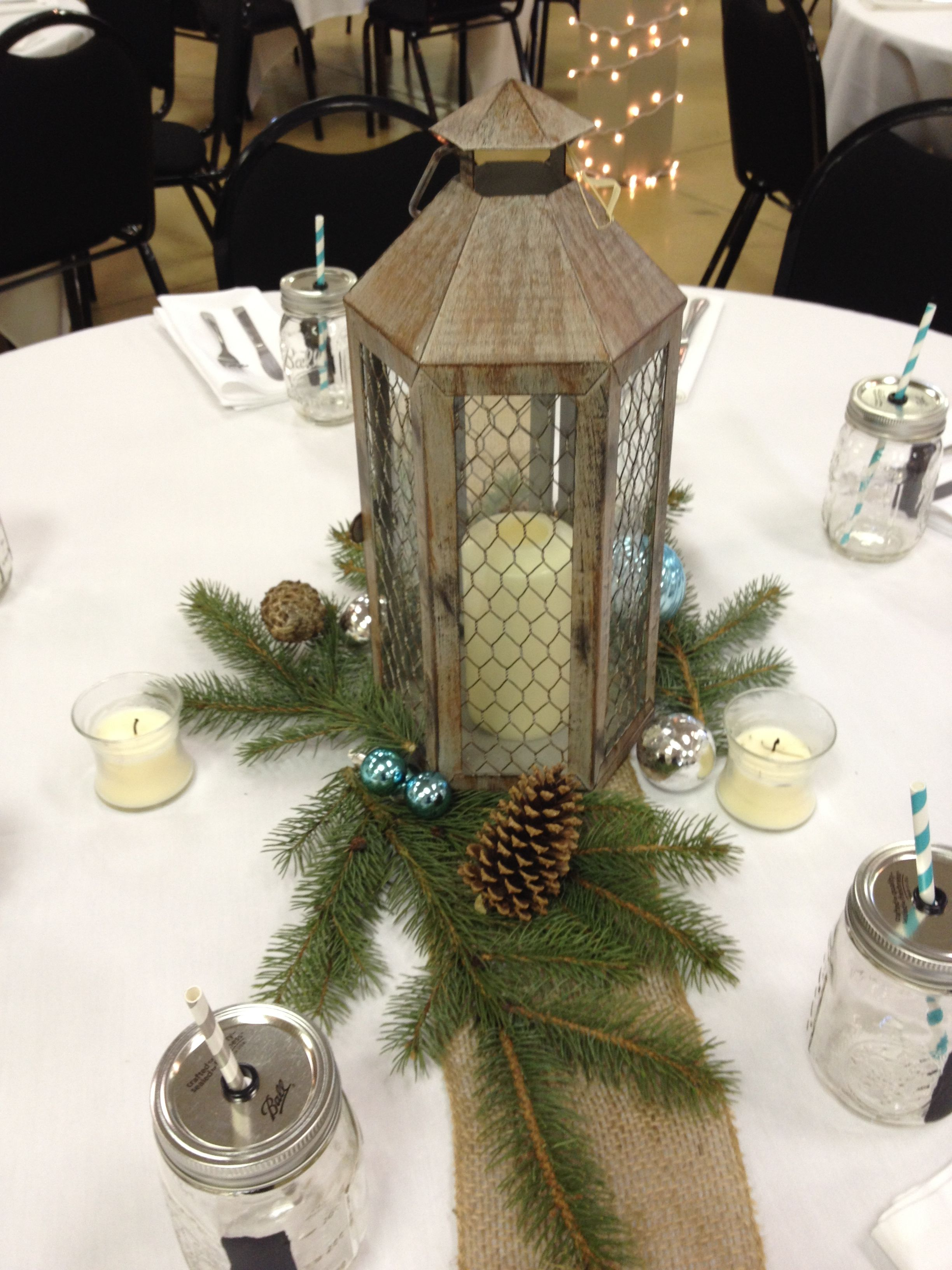 Simple Winter Wedding Centerpiece With A Lantern In The Center