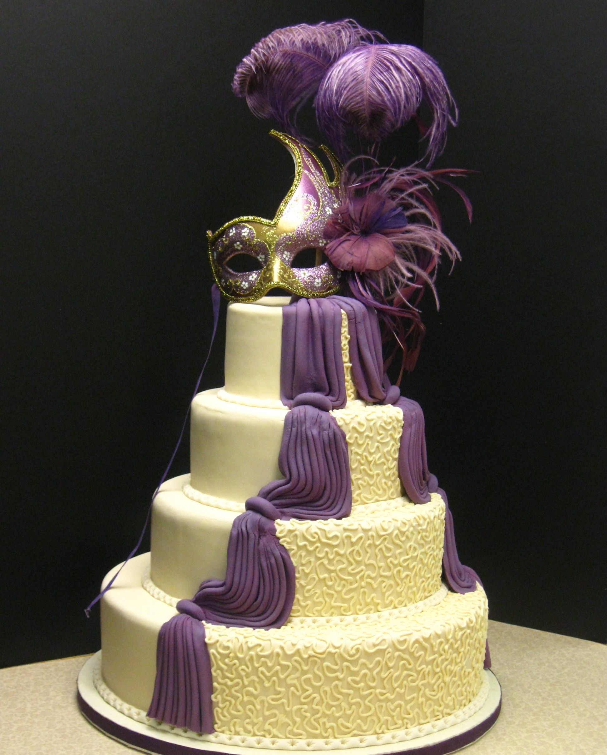 Masquerade Ball Wedding Ideas: Dramatic Wedding Cake With Purple Fondant Draping And A