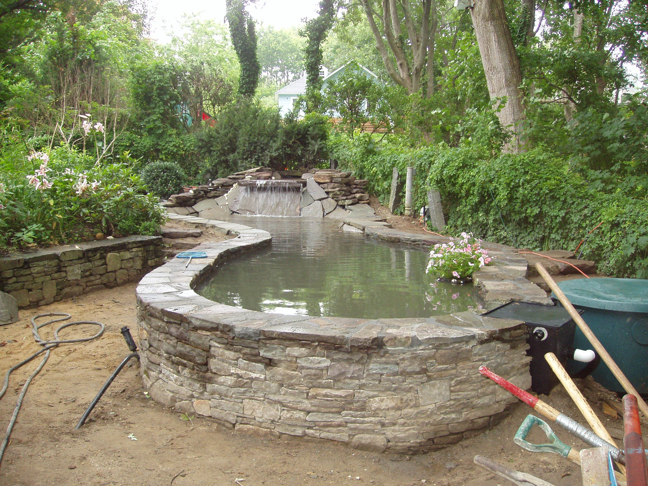 Stone above ground ponds at the same location an extra for Pond building ideas