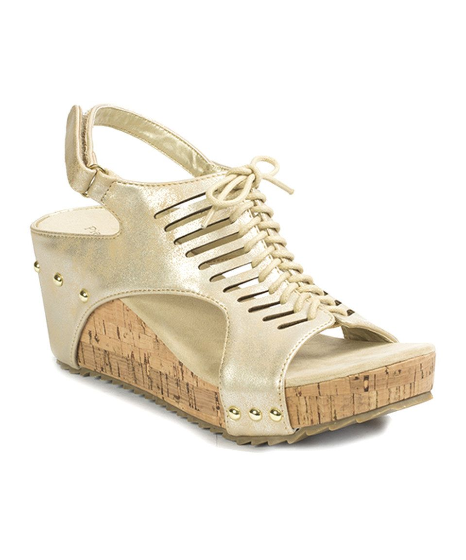 Take a look at this Pierre Dumas Distressed Gold Giselle Sandal ...