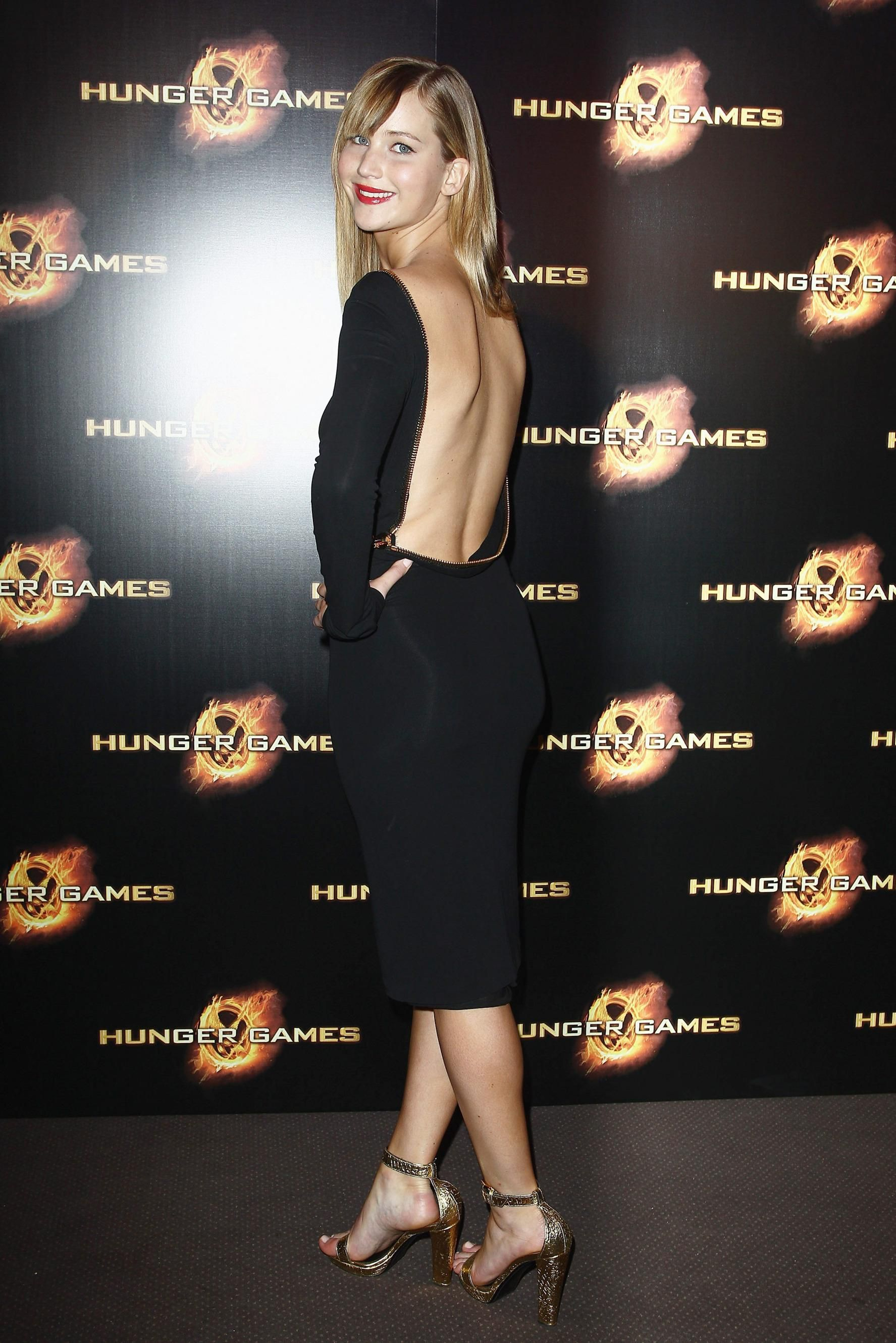 f5f2ca23fdeb0 ... Jennifer Lawrence s Stunning Hunger Games Premiere Looks So Far! Tom  Ford Backless Zipper Dress Is One Of The Sexiest Dresses Of All Time