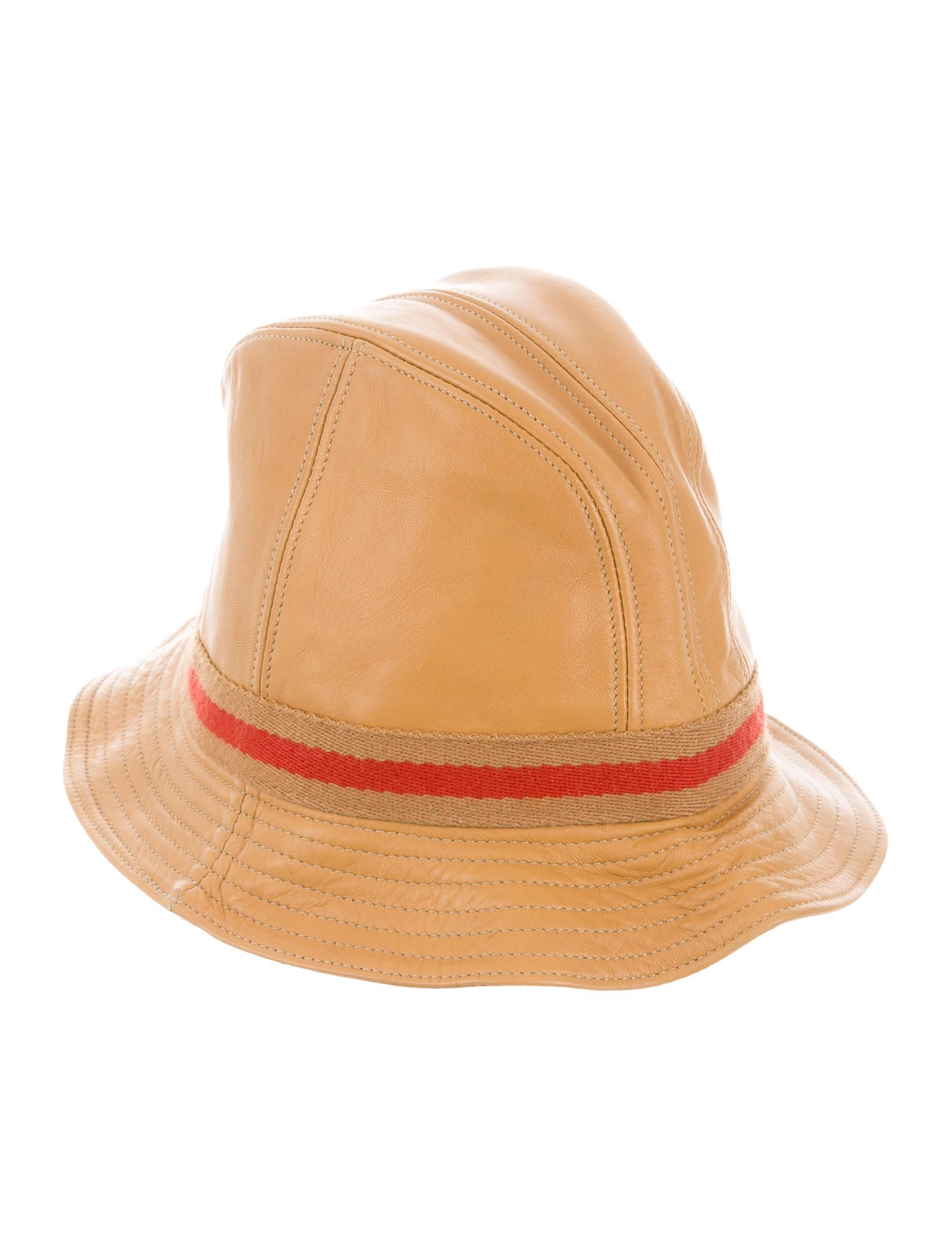 42e98c9f5ec Tan leather Gucci bucket hat with brown and red canvas trim featuring  gold-tone logo embellishment. Designer size M.