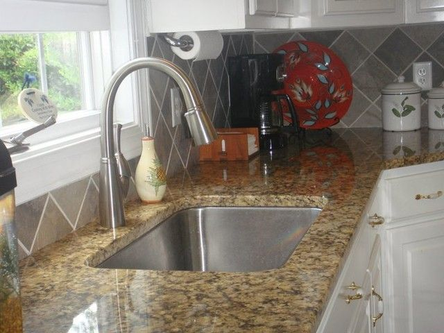 Brushed Nickel Faucet With Stainless Steel Sink