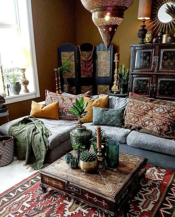 Photo of a modern Moroccan living room with Moroccan lamps, a patterned coffee table and …