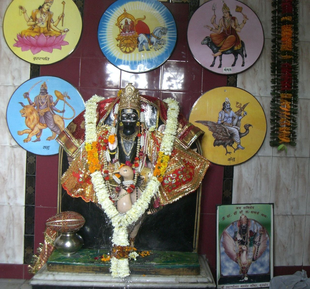 Statue of shani saturn with the paintings of the navagraha the nine planets