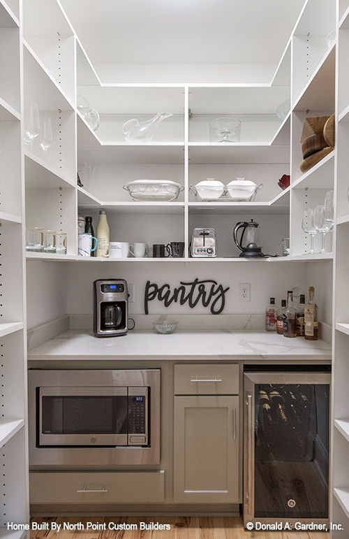 Pantry of The Wallace house plan 1446 built by North Point Custom Builders!   #wedesigndreams #dongardnerarchitects #architecture #architect #houseplan #homeplan #dreamhouse #dreamhome #floorplans #newhome #newhouse #pantry #wetbar #coffeebar
