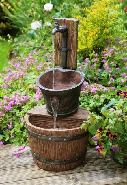 Fuente de agua jarrones de miel con grifo de hierro jard n for Decoracion hogar jarrones