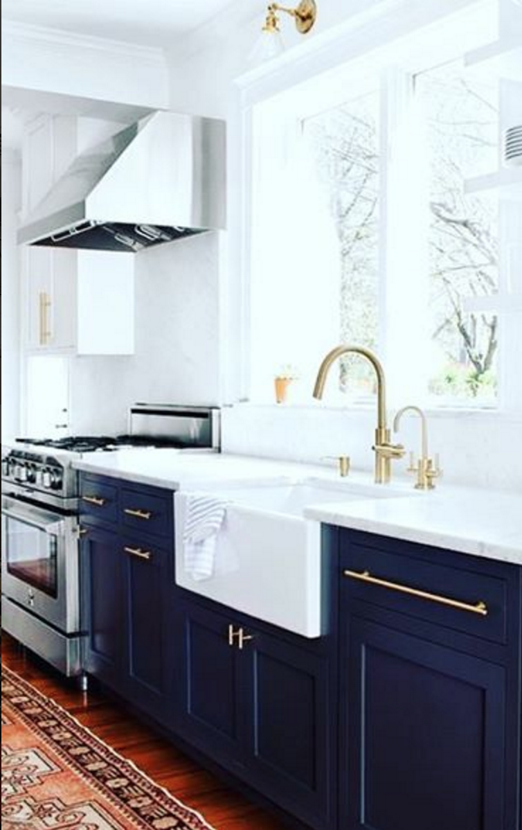Gorgeous kitchen with dark navy cabinets gold