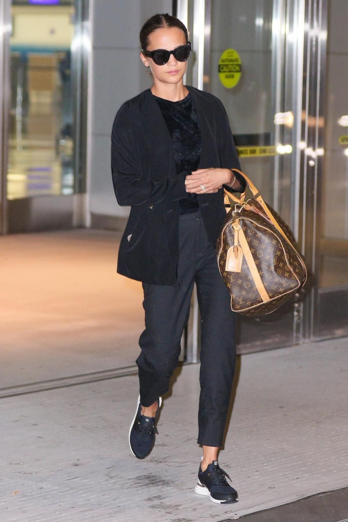 29e89803361e Alicia Vikander wearing Louis Vuitton Weekend Bag and Louis Vuitton  Aftergame Sneakers