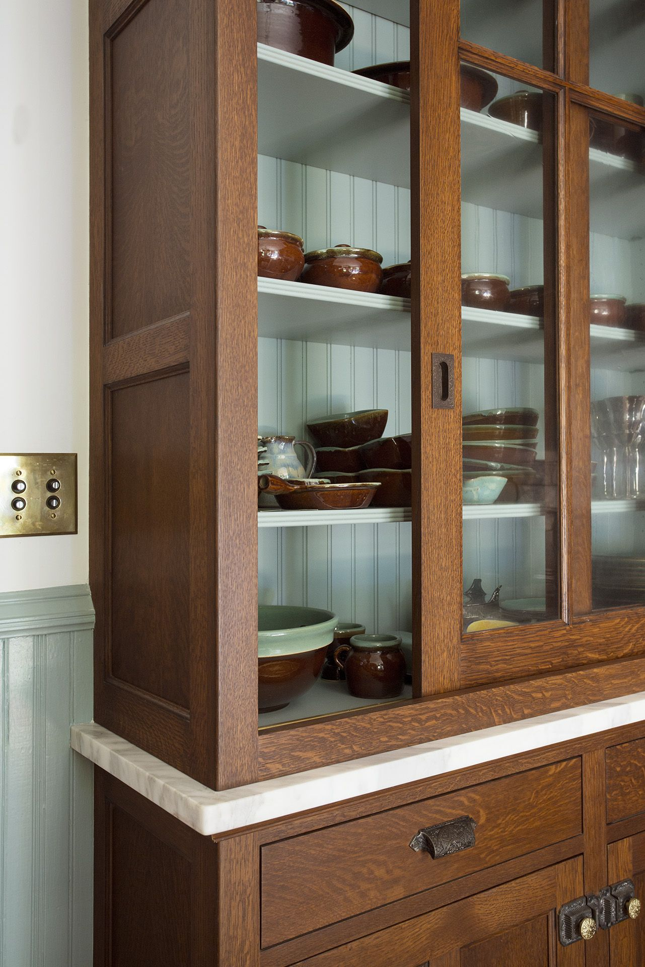 A Cornerstone Of The Capitol Hill House Renovation Was Transforming An Early 1900s Kitchen Into A Space Glass Kitchen Cabinets Oak Kitchen Cabinets Oak Kitchen