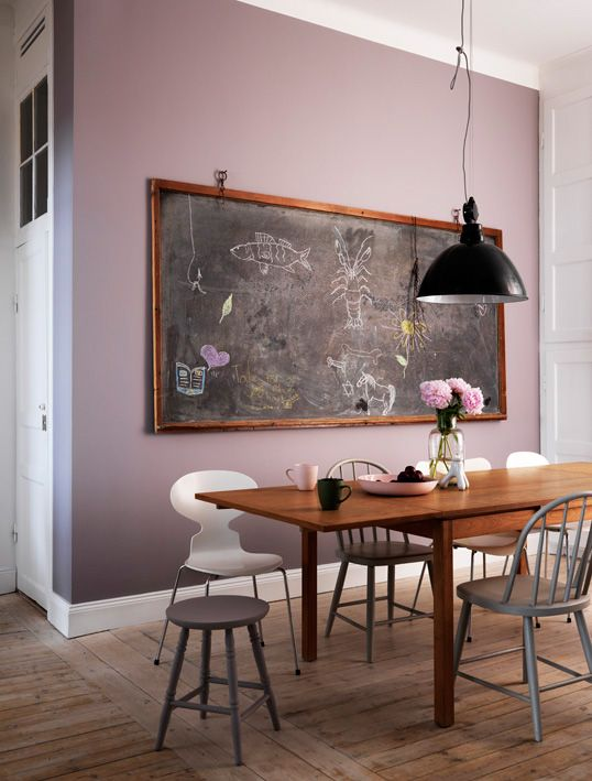 A giant blackboard acts as double duty for art and function in this