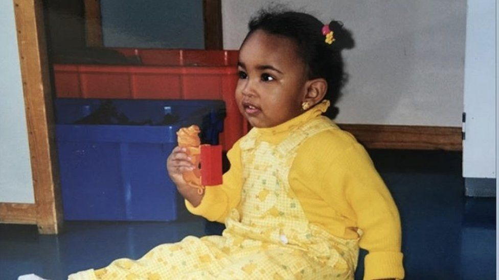 Ikram aged one in Sweden - her mum described how she liked to match colours when choosing clothes from an early age | Ikram Abdi Omar