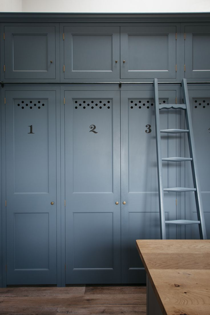 Dorset Farmhouse Farm Kitchen featuring bespoke storage pantry by Plain English.  Sign written numbers.  Sliding Ladder and Rail.  Georgian Folgate doors.  Ventilation Holes. #plainenglishkitchen