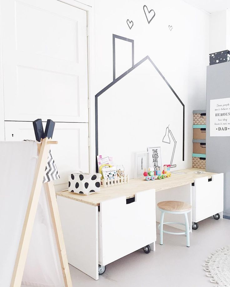 Love the washi tape wall decoration in this bright and fresh room