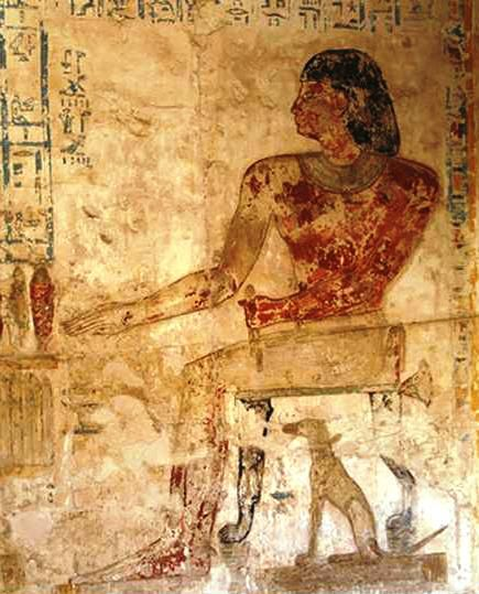 Figure 10. Pabasa with pet dog Hekenu, Asasif. Twenty Fifth Dynasty. Photograph by P. Gorgori