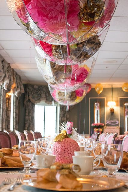 pink and gold april showers bridal shower that is so stinkin cute with the pom flowers in an umbrella hanging upside down