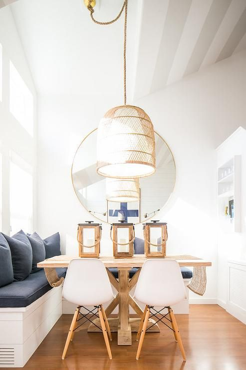 Hung From A Vaulted Ceiling In Fron Tof A Round Gold Mirror A Basket Pendant Light Illuminates Living Room Lighting Dining Room Chandelier Modern Dining Room