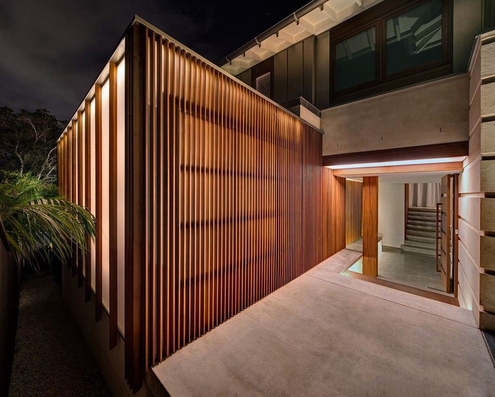 This exciting Home using landscaping outside ideas and also striking soft house style layouts demonstrate enticing evening view of the home using timber shutters inside the entrances.