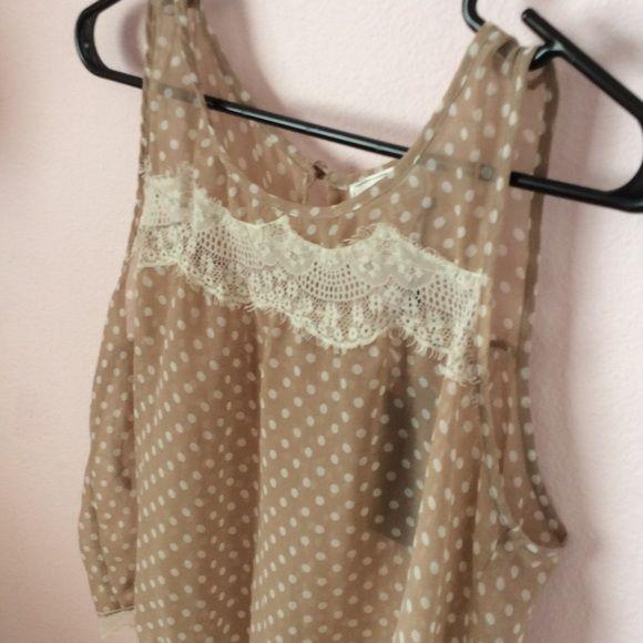 NWT Tan polka dot top Tan with cream polka dot top. Lace in front and at bottom of shirt. Tops Tank Tops