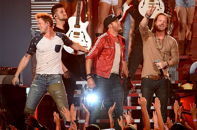 Luke Bryan and Florida Georgia Line perform onstage during the 2014 Billboard Music Awards at the MGM Grand Garden Arena on May 18, 2014 in Las Vegas, Nevada.