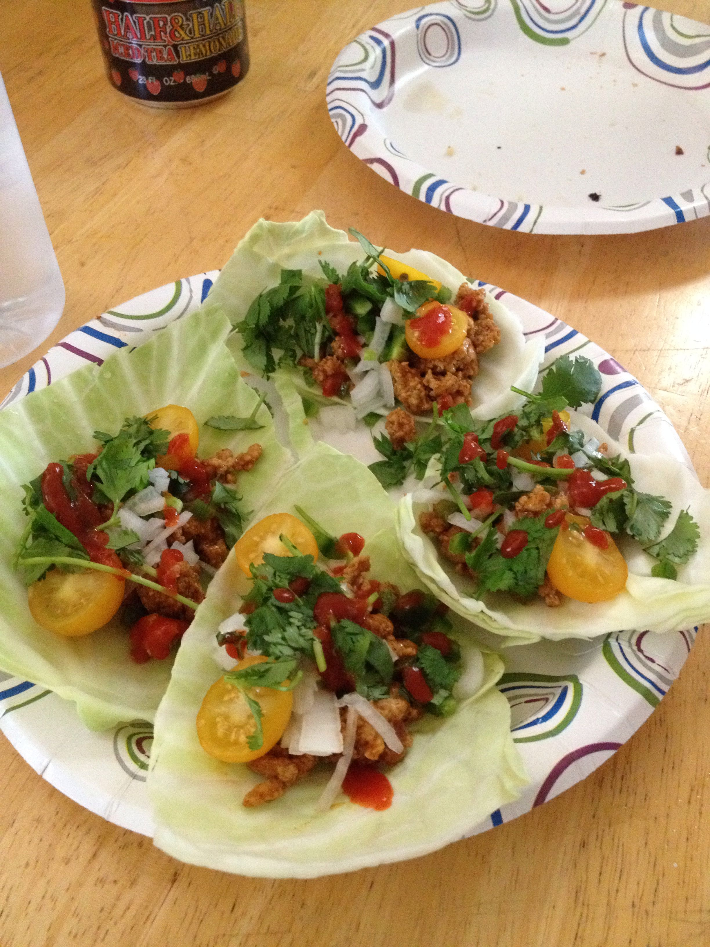 Turky tacos on cabbage leaves. Pound ground turkey  ( I eyeballed the rest sorry) Tomato sauce Cumin Chilli powder Garlic powder Onion powder  Salt  Pepper Minced jalopino cood in meat. Then I topped with chopped onion fresh jalopino and  cilantro . Then cherry yellow tomatoes . And of corse stirs sriracha sauce