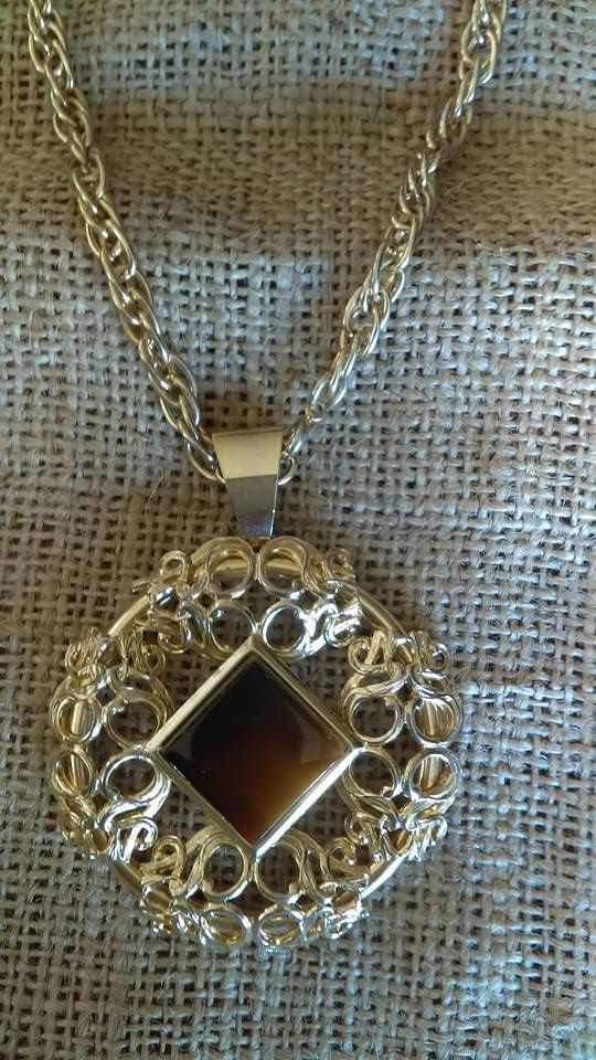"""#694 Gold tone pendant with brown """"stone"""" and knotwork design,  2 1/4"""" wide, on heavy chain that is 23"""" total length, $22"""