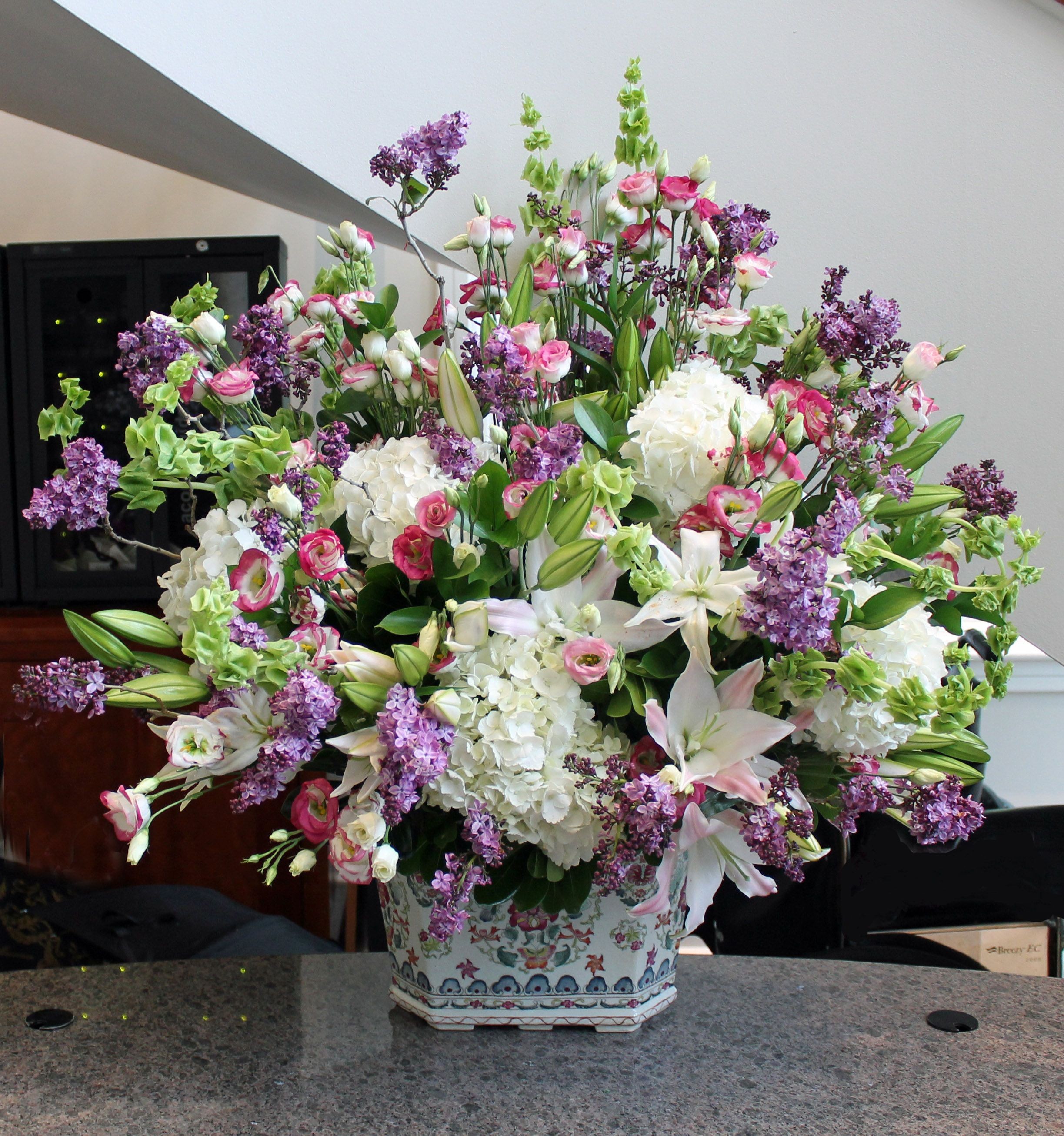 Arrangement From April 29 2014 Lilies Lilac Bells Of Ireland Lisianthus And Hydrangea Flower Arrangements Floral Arrangements Summer Floral