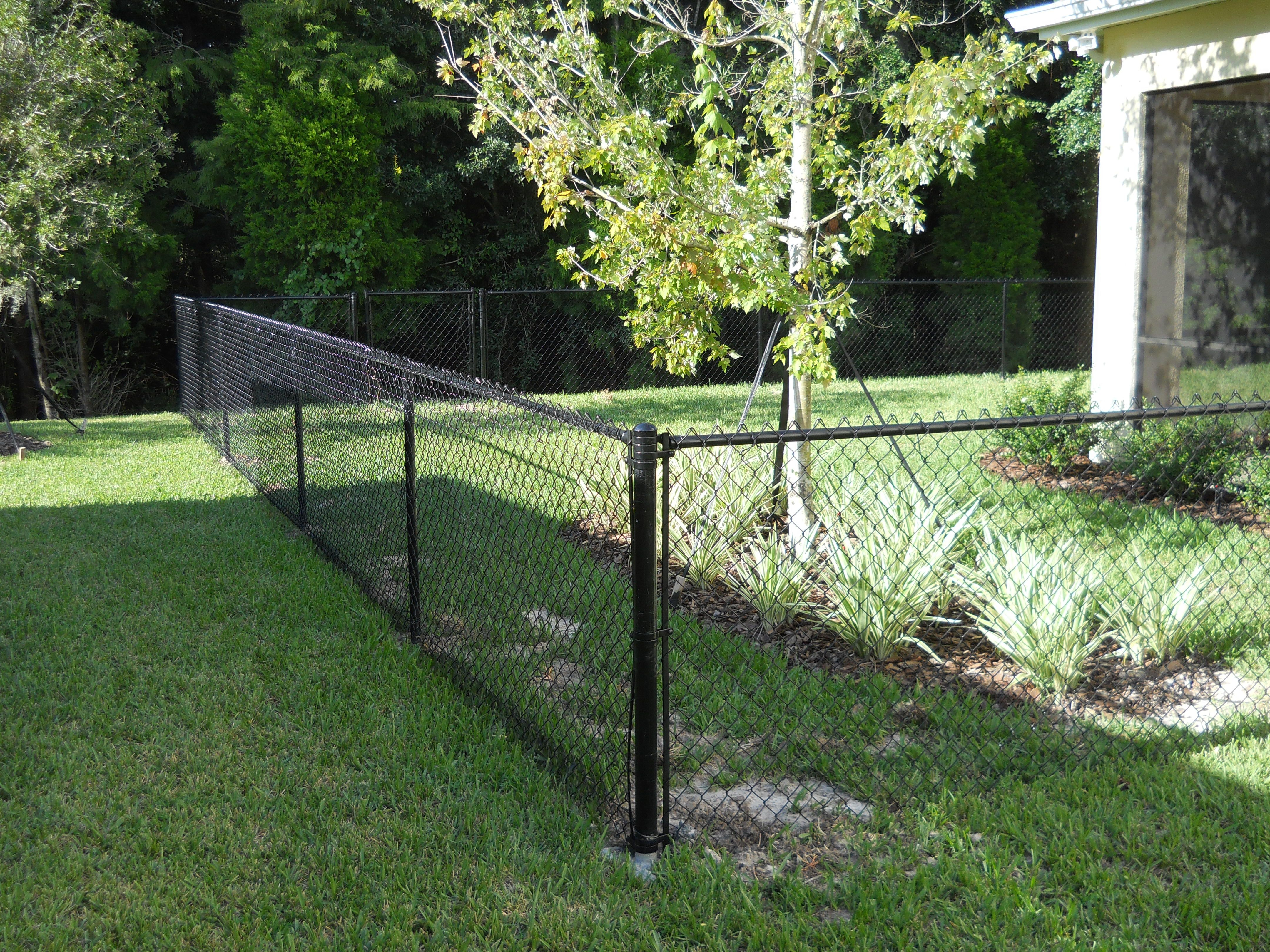 4 tall black chain link installed by White Fence pany creates
