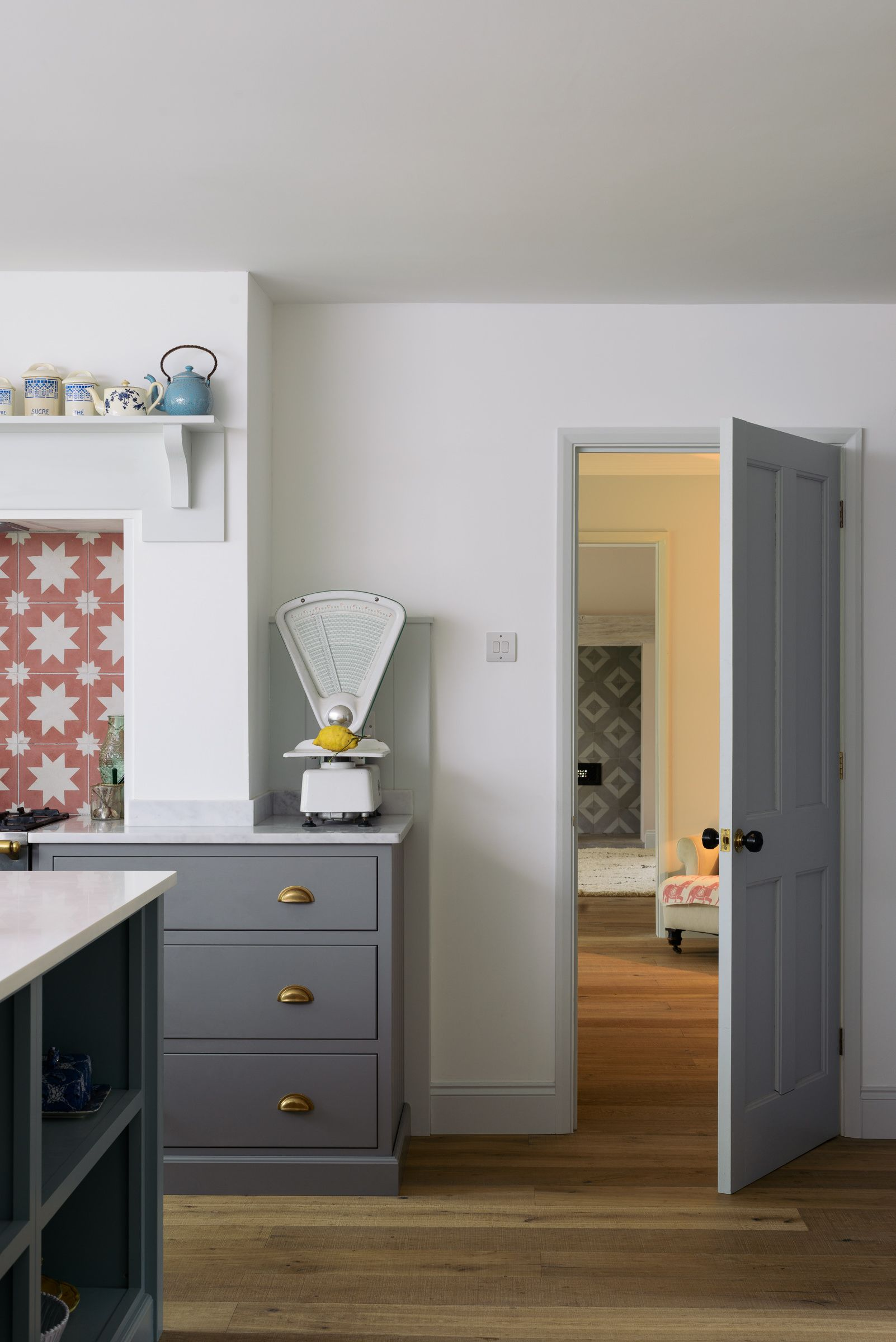 White walls, grey cupboards and brass hardware look perfect in this ...