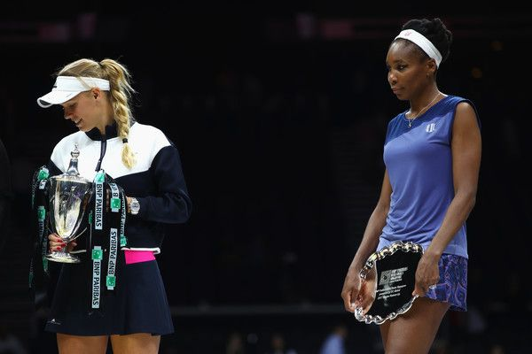8c682d5a838 Winner Caroline Wozniacki of Denmark holds the Billie Jean King trophy with  runner up Venus Williams