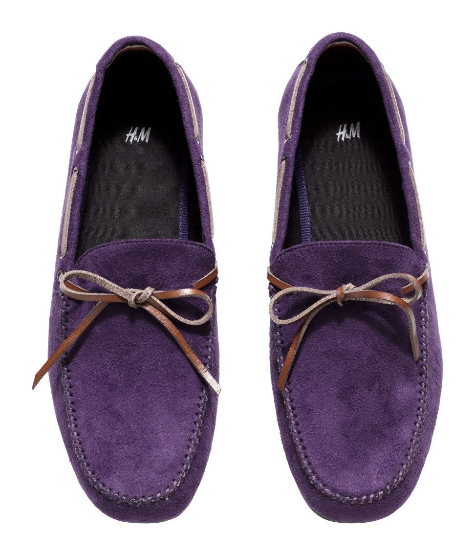 bfbd610d9f7 Add flair to any outfit with these purple faux suede loafers.