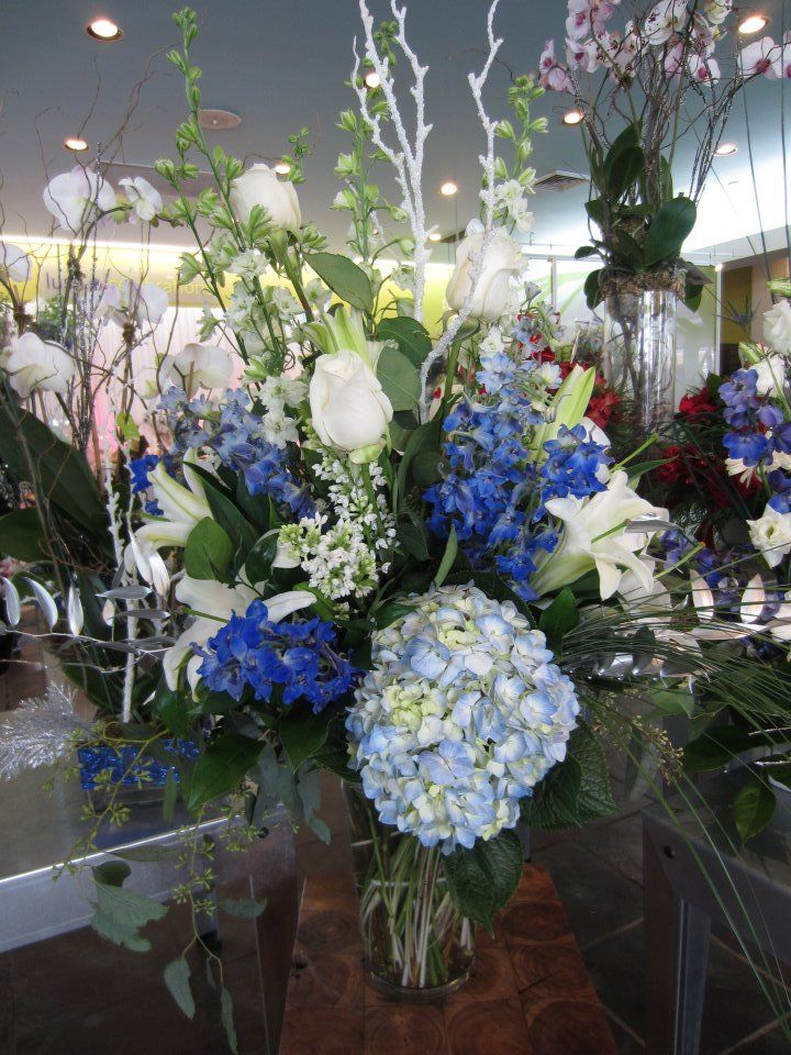 Beautiful hydrangeas white roses blue delphinium with for Flower arrangements with delphinium