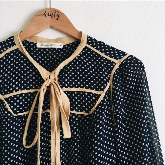 Polka dot blouse! This beautiful navy polka dot blouse with yellow buttons is too adorable! It's pretty sheer and lightweight but prefect for warm summer days! 100% Polyester. Tops Blouses