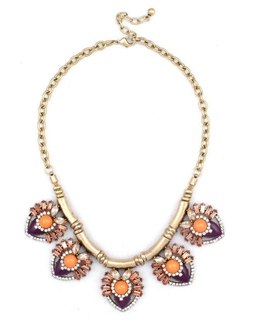 A row of sparkling coral-hued stones brings a splash of warm color to a pretty statement necklace.   $55.00