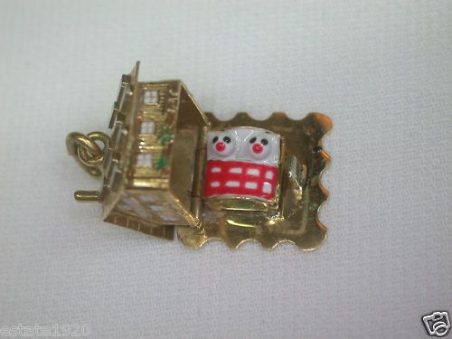 ANTIQUE VINTAGE ENAMEL CHARM  {International Buyers Are Responsible For Customs & Duty Fee's}  CIRCA ~ 1940's  METAL ~ 18K YELLOW SOLID GOLD  ENAMEL ~ WHITE, GREEN, BLACK & RED  WEIGHT ~ 5.4 GRAMS  ~ SIZE ~  NORTH TO SOUTH ~ 14.07 MM (0.5535 INCHES)  EAST TO WEST ~ 14.19 MM (0.5585 INCHES)  THICKNESS ~ 11.54 MM (0.454 INCHES)