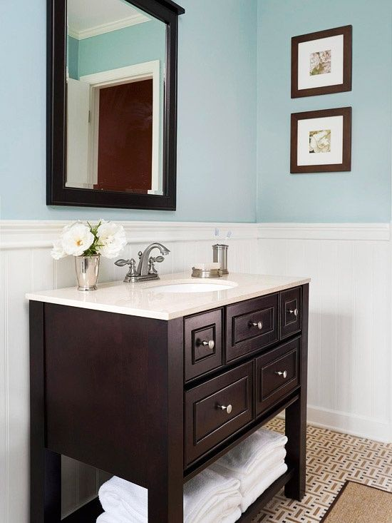 Light Blue Paint In Bathroom With Dark Wood And Counters