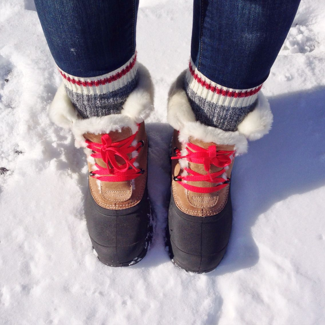 Sorel boots with red laces for winter
