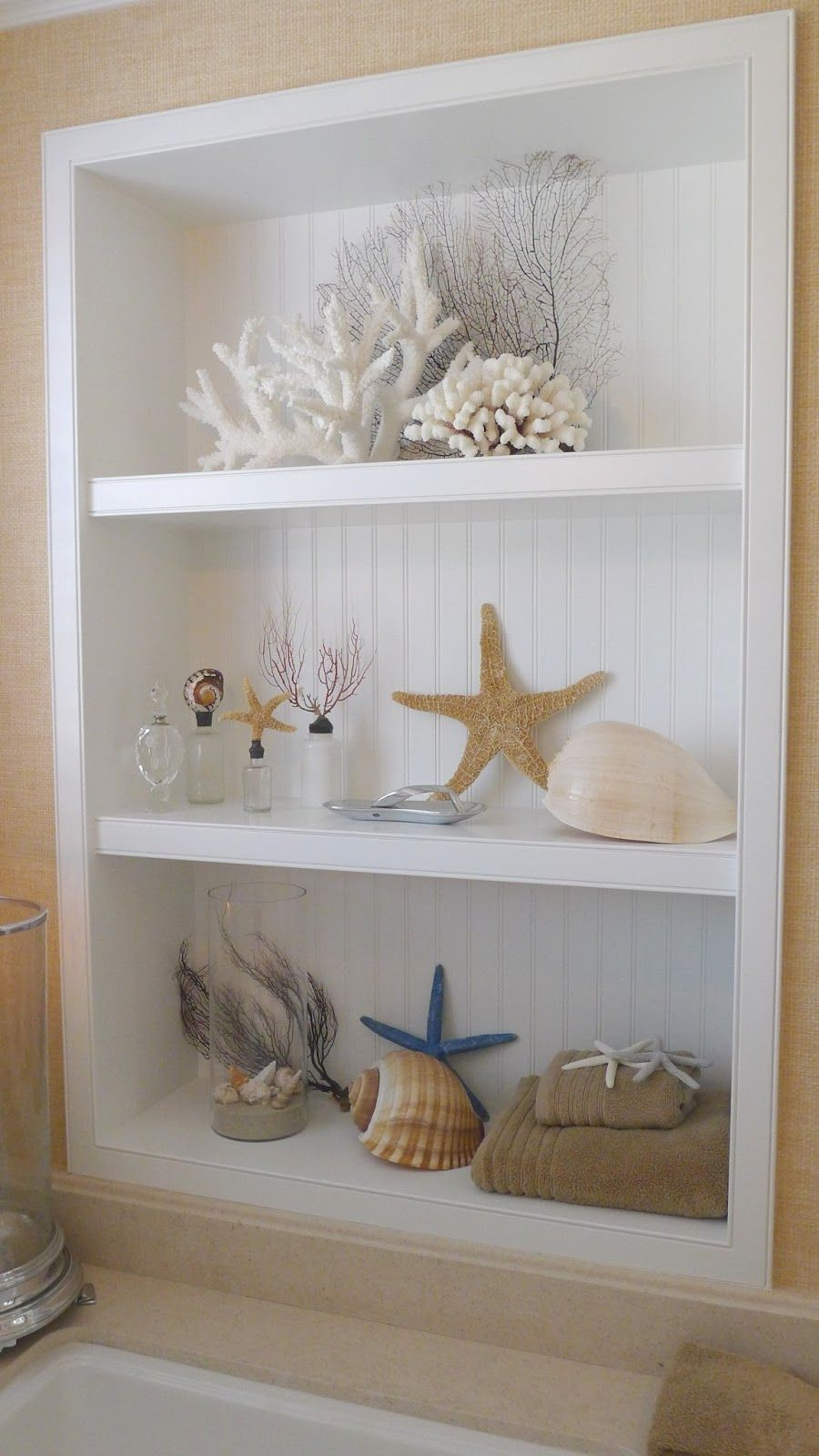 Sea shells love the built in beadboard shelves for Seashell bathroom accessories