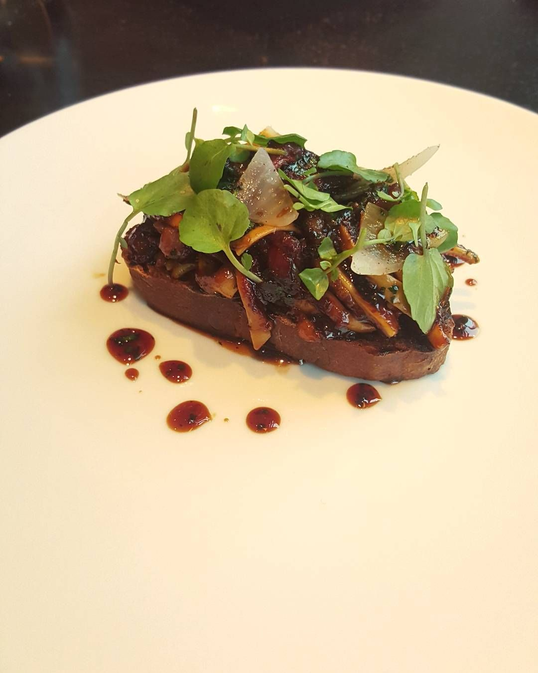 Bold delicious sticky sliced pig's ear ragout on toast. by alastiar_tan