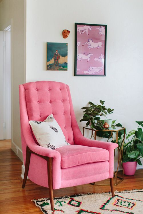 Framed wallpaper (or fabric!) matching with an armchair (via Design ...