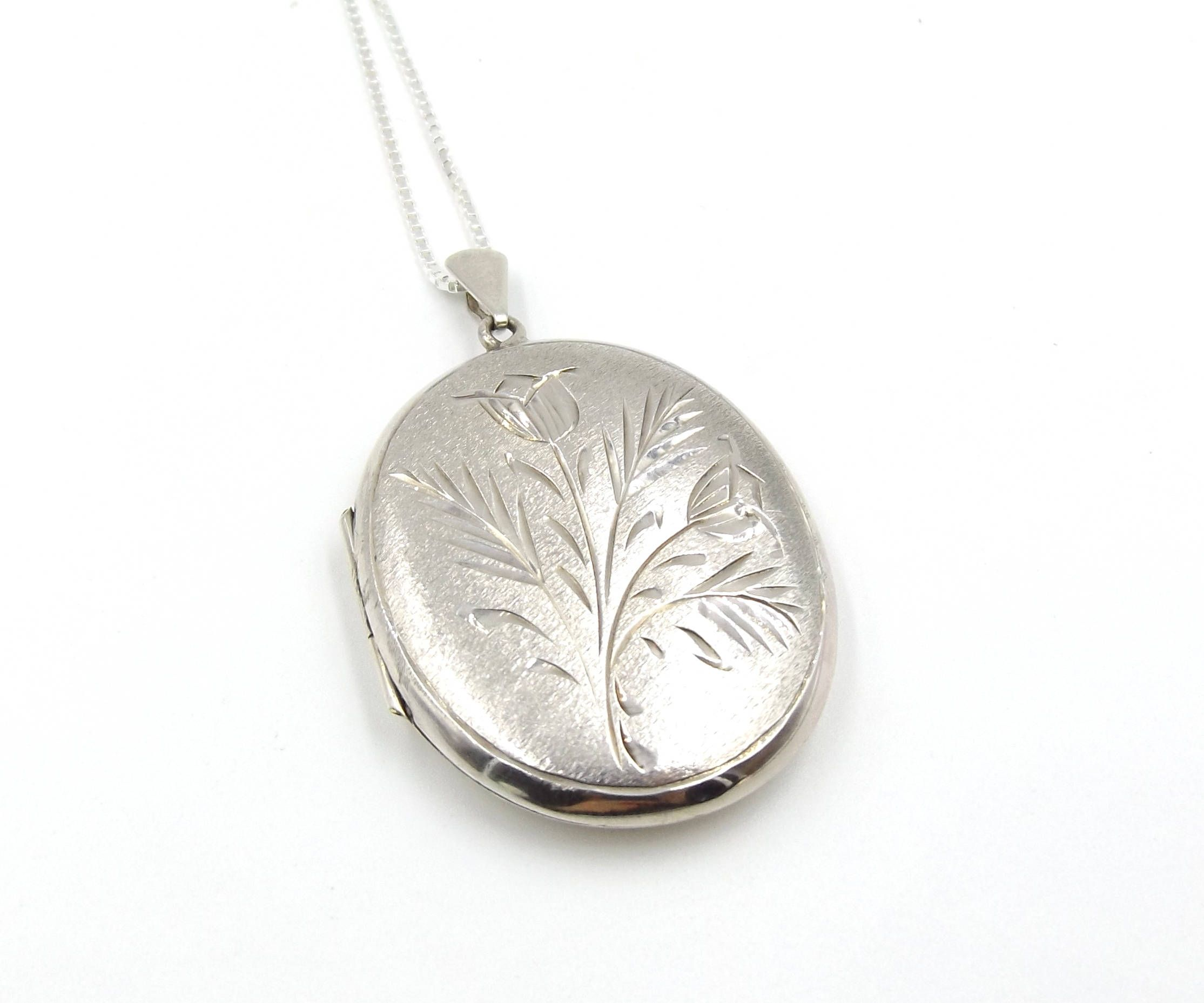 in we lockets silver pulse range supporting gold have necklaces exhibitor large rose products locket and image of a